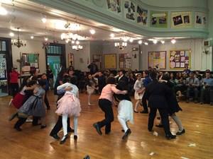 students performing group ballroom dancing