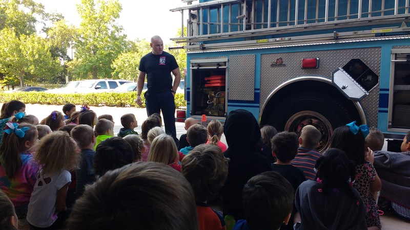 MCFD showing the students equipment on the firetruck.