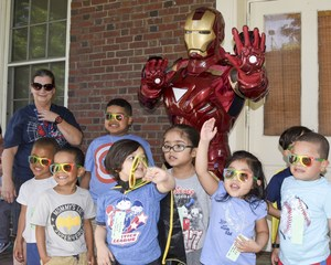 Readiness students waving with Iron Man