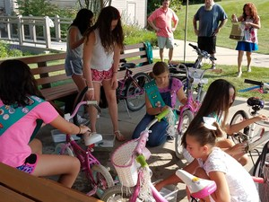 Girl Scouts repairing bicycles.
