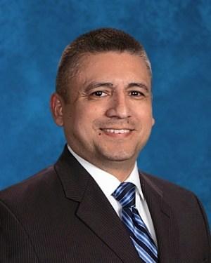 Board Clerk - Armando Urteaga