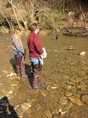 Students wade in the Montour Creek for a hands on learning experience