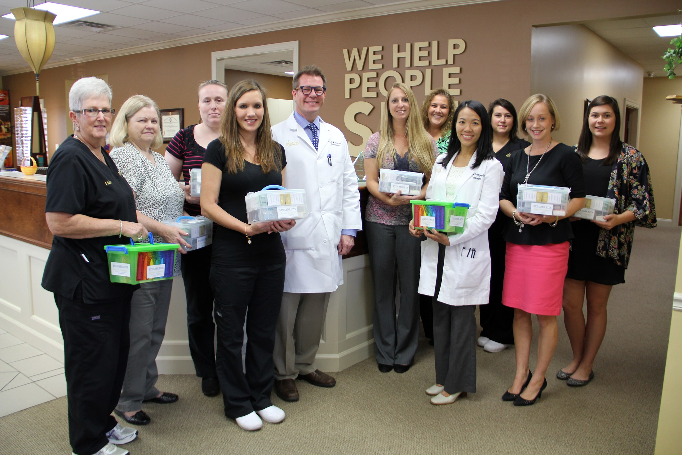 Staff with donated eye care kits