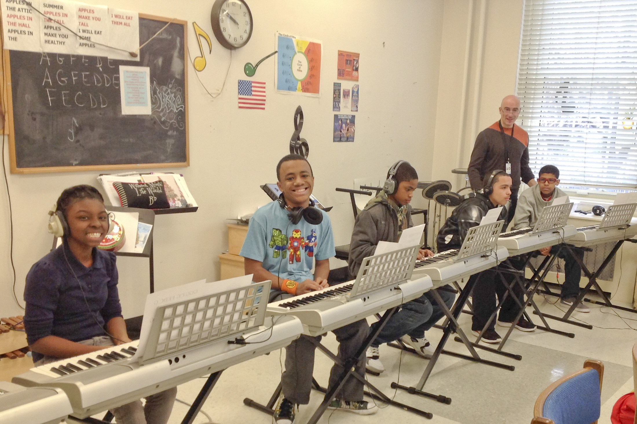 Students on keyboards in the music room