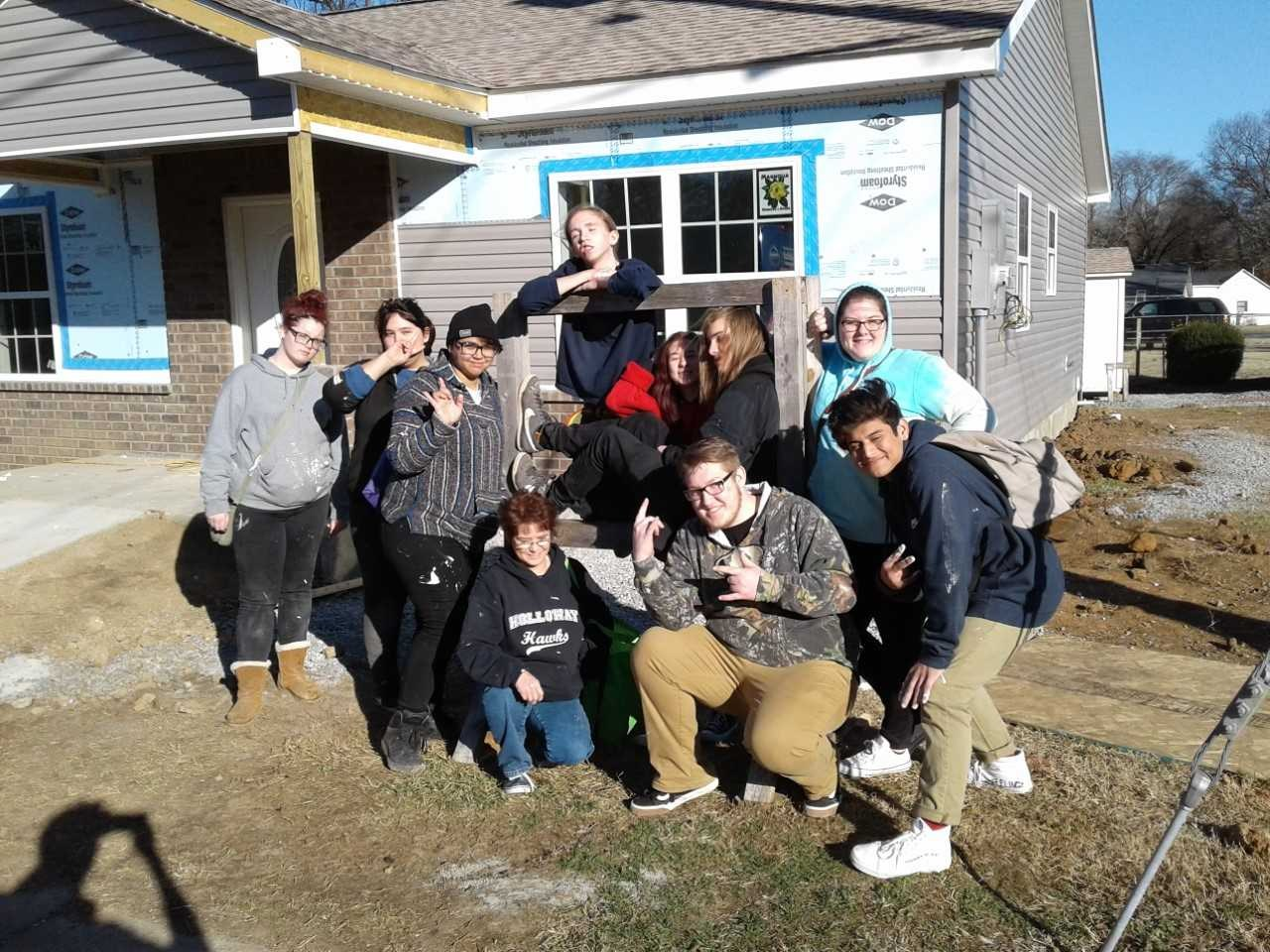Printed Word Book Club helping with Habitat build