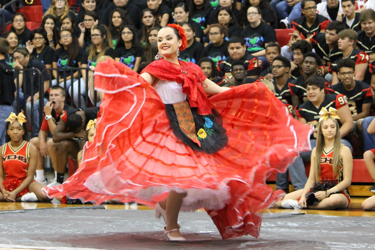 victoria east high school folklorico dancer performing at a pep rally