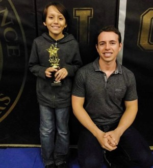 Ryan Lerma and Chess Coach Colt Munoz