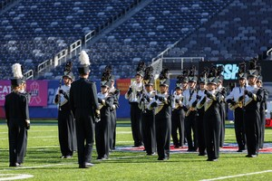 Hopewell Valley's Marching Black and Gold prepare to perform their show