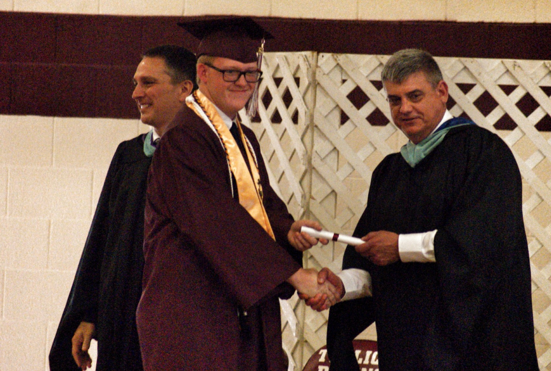 Senior accepts diploma from Director Tim Blankenship.