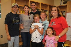 Ybarra Oliver Family with Check Donation.JPG
