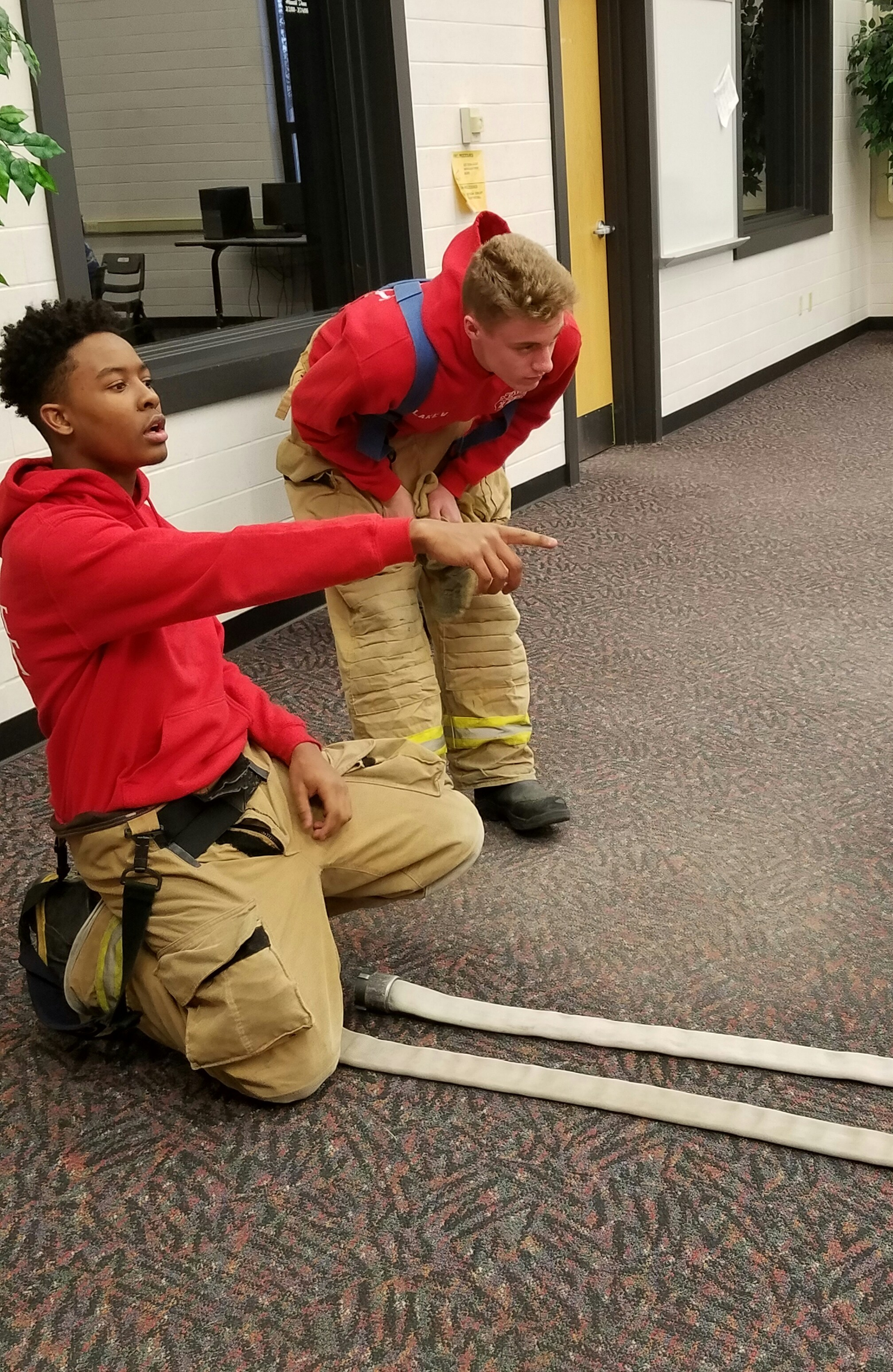 fire students rolling hoses