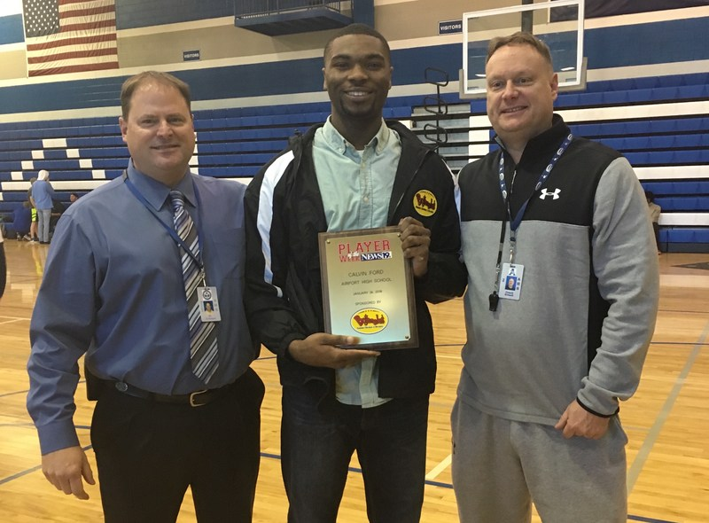 Calvin Ford, center, with Airport principal Brad Coleman, left, and coach James Kinard