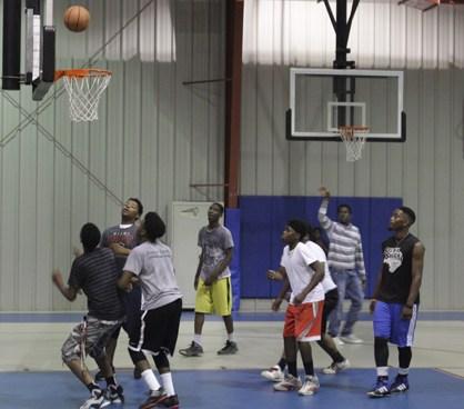 Several young men playing basketball