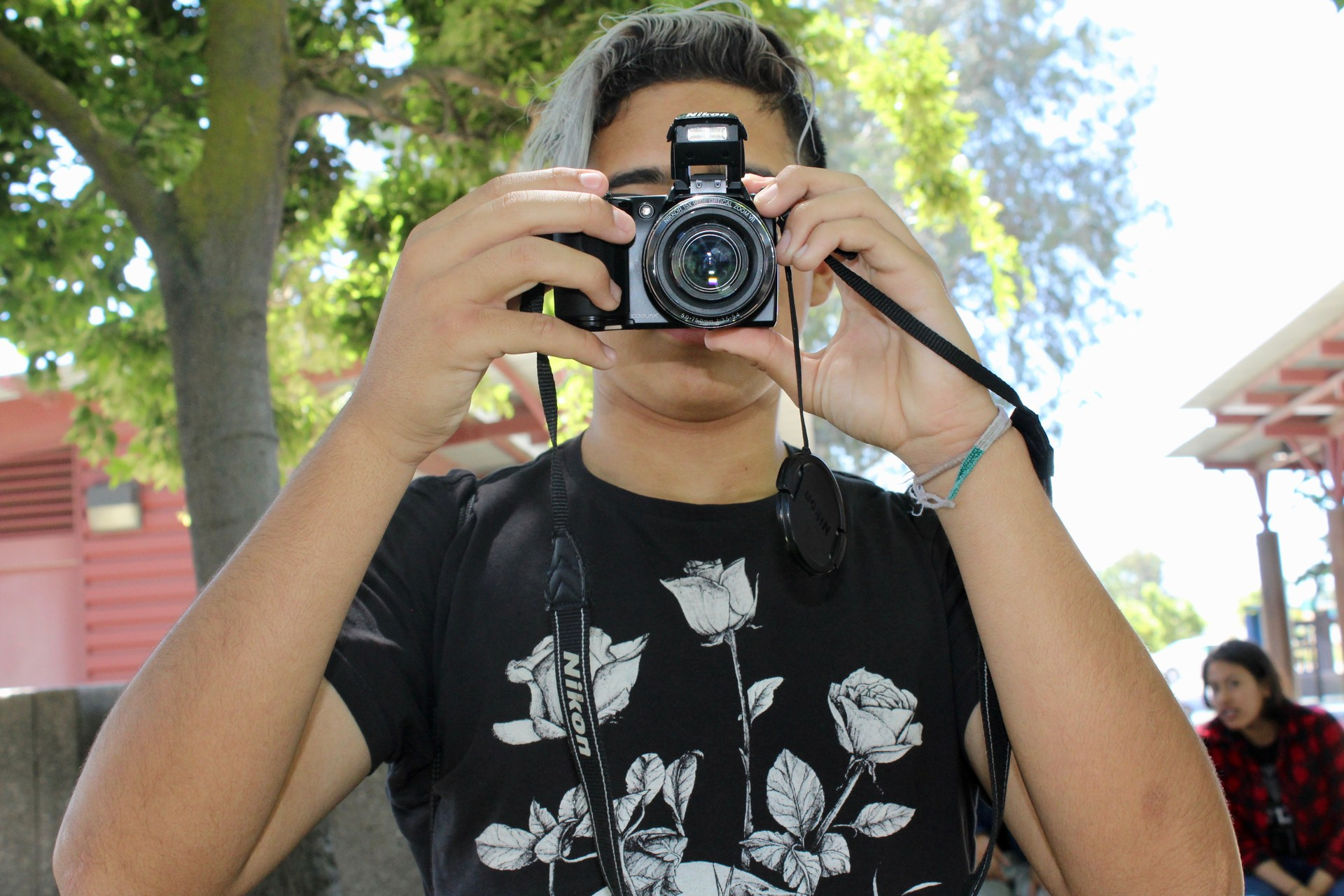 Student with a camera