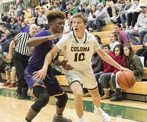 Coloma's Zach Goodline (10) dribbles against South Haven