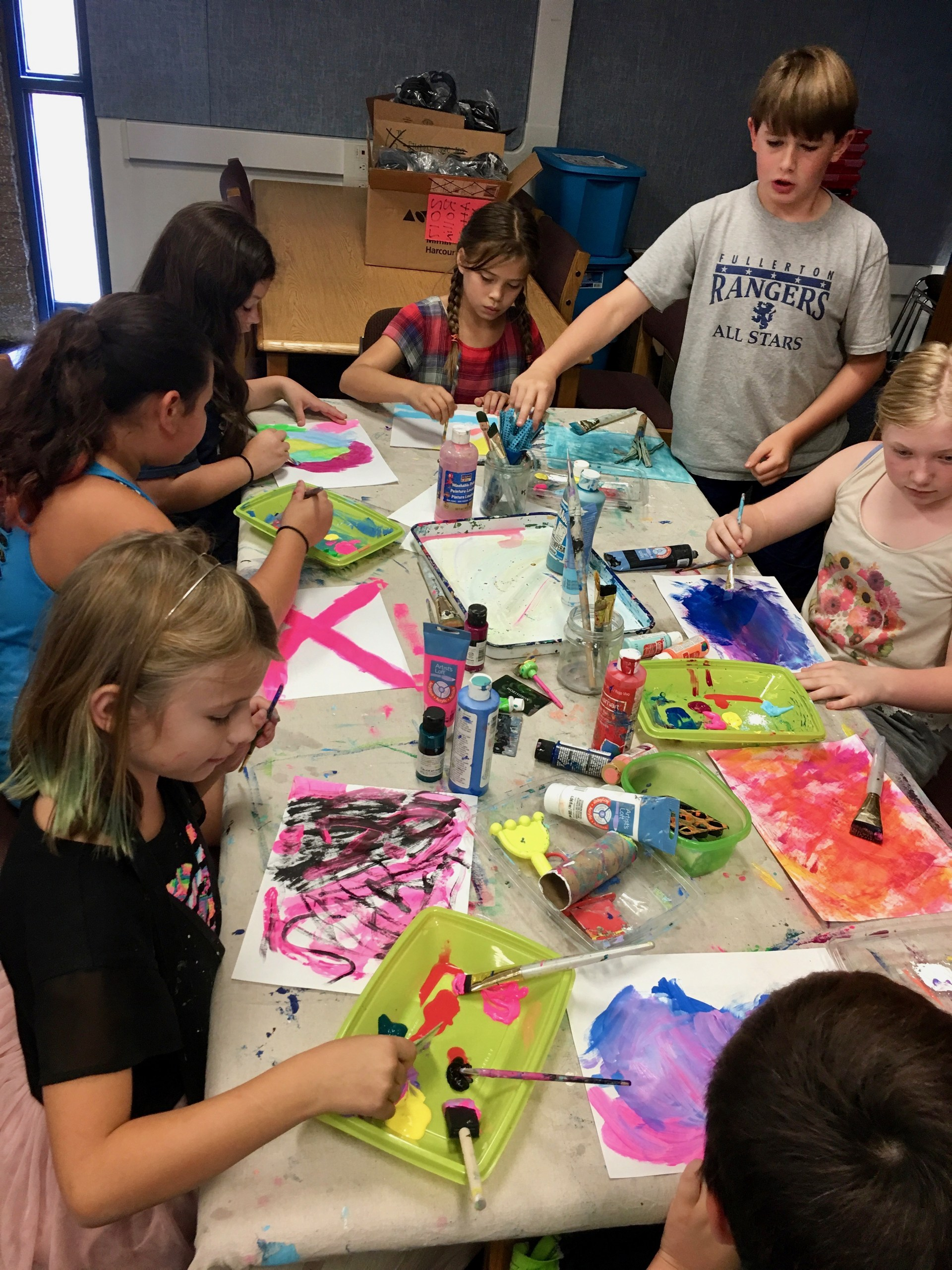 Students working on a painting project.