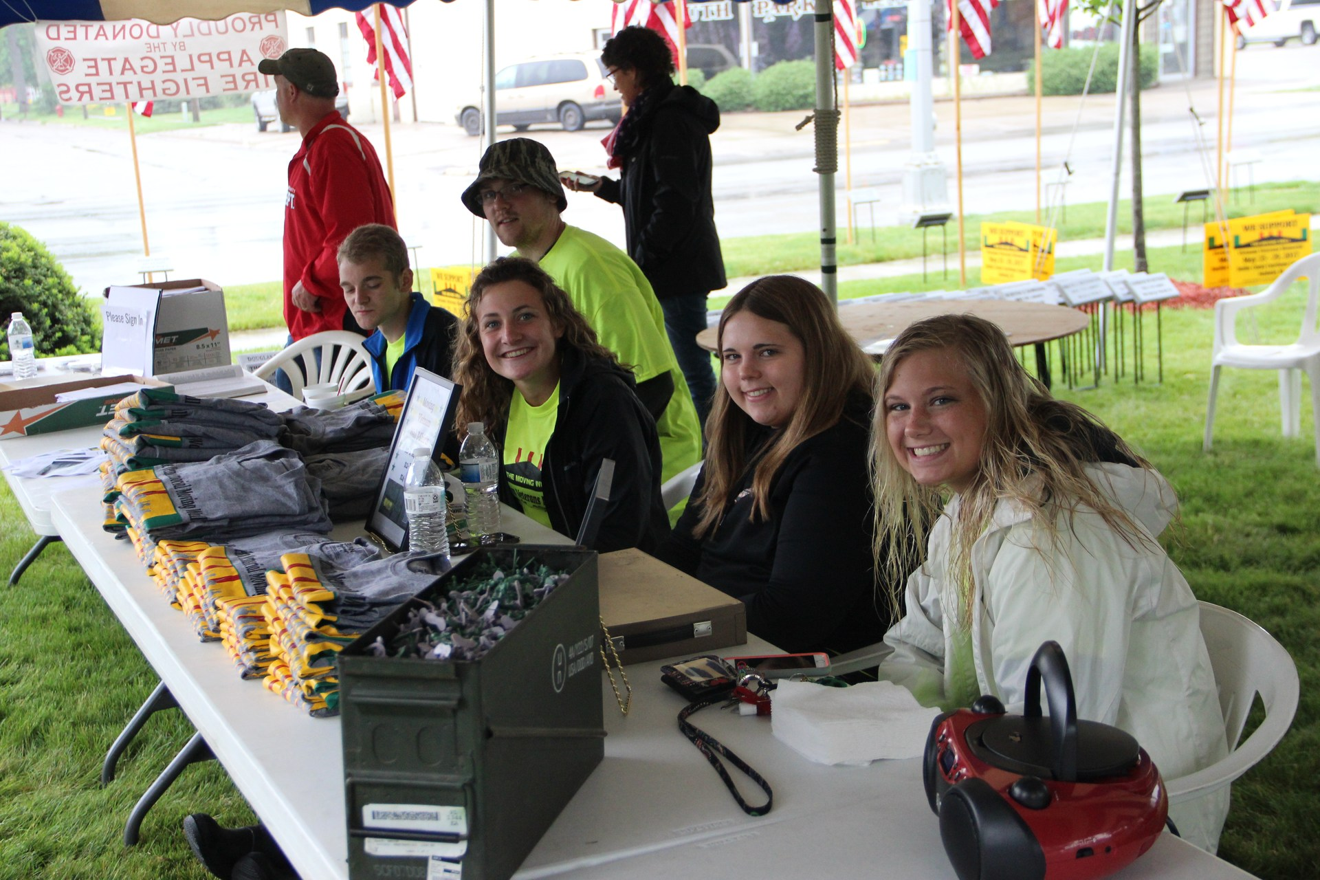 Students run the information tent.