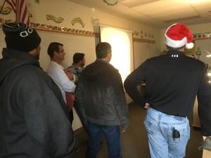Assistant Principals and a few staff enjoy Spanish III singing Christmas Carols in Spanish