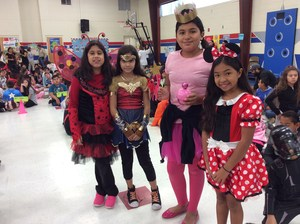 Students in character disguise in gym.