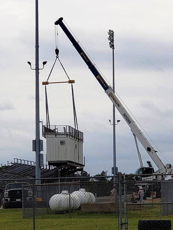 Photo of Trojan Stadium press box being removed - side view