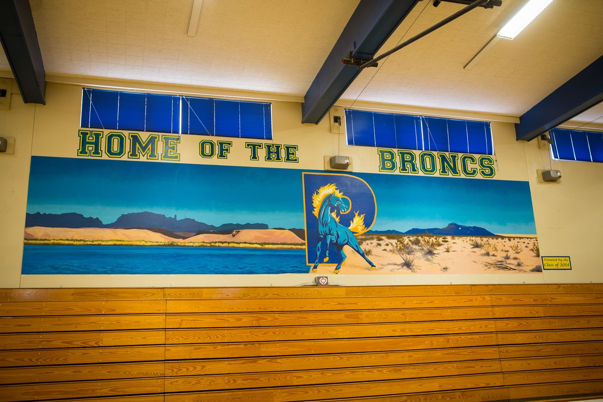 high school home of the bronc sign