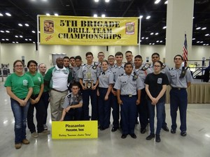 Large group of JROTC students with instructors.