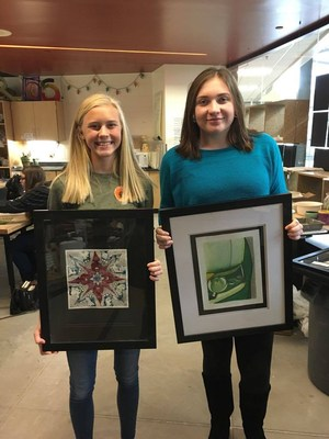 TKHS students show their artwork that will be displayed in the village.