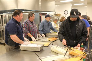 People being served at the bean feed
