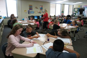 Students work on a writing assignment about why it's important to have class rules.