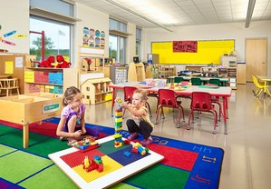 Students in Classroom Stacking Blocks
