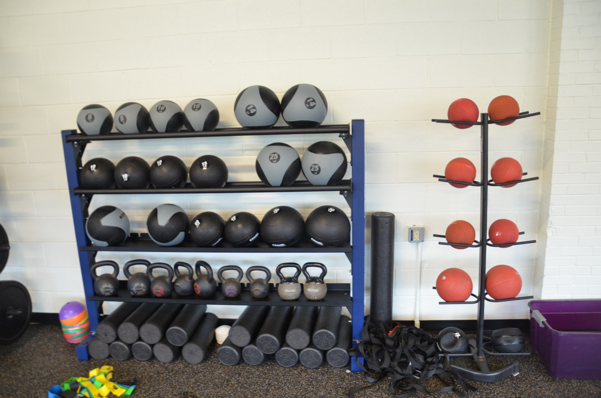 Up close picture of medicine ball rack in Coach Paternostro Training Center
