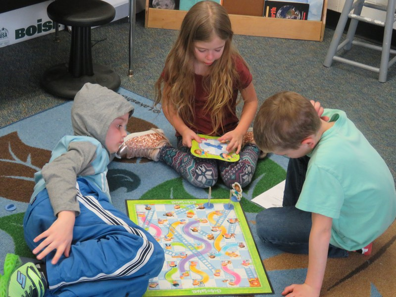 McFall students play a game of Chutes and  Ladders.