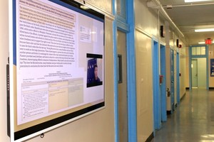 digital bulletin board in an empty hallway.
