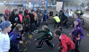 Students attending the before-school program (the 100 mile club) play fun games to add more exercise to their day.