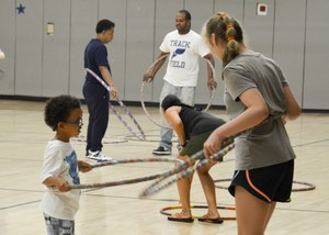Instructor teaching the hoopers.