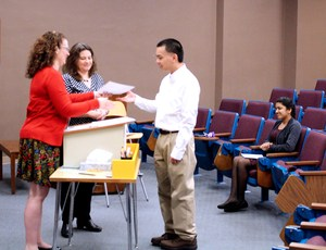 S. Nguyen  receiving her certificate from Joeal Mazurowski and Sherri James