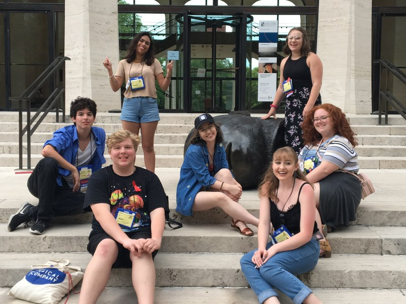 BHS theatre students sitting on concrete steps