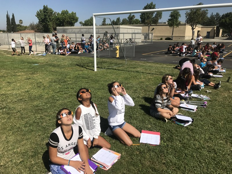 6th grade students use their specials goggles to view the eclipse.
