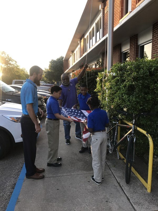 Student help with the American flag