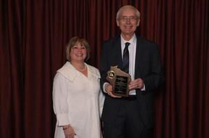 Principal of Veritas accepting award