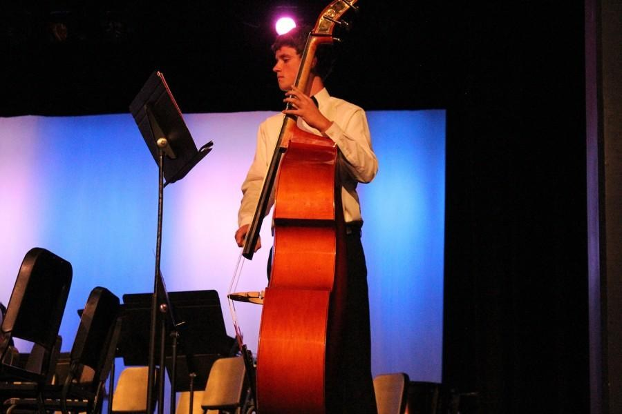 a young man playing his Bass Cello.