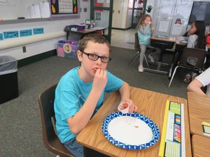 A Lee student enjoys some chips and salsa - made in Michigan.