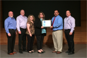Magnolia ISD Transportation Dept. receiving Tyler Excellence Award 2016.png