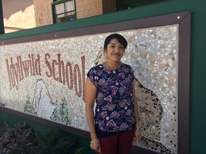 Mary Pimentel in front of the Idyllwild School sign.