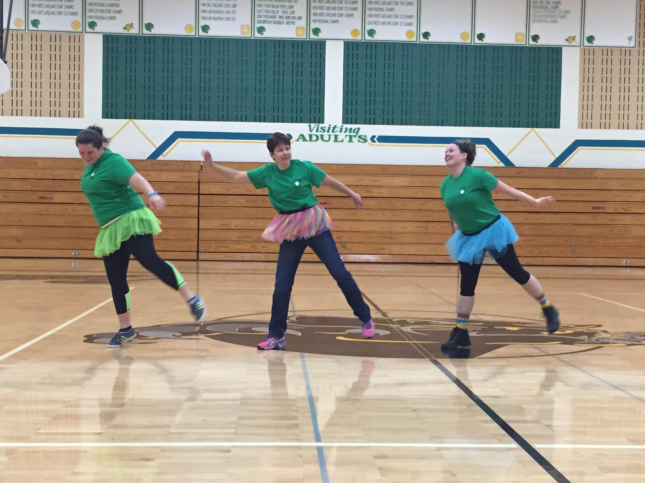Teachers dancing in tutus.