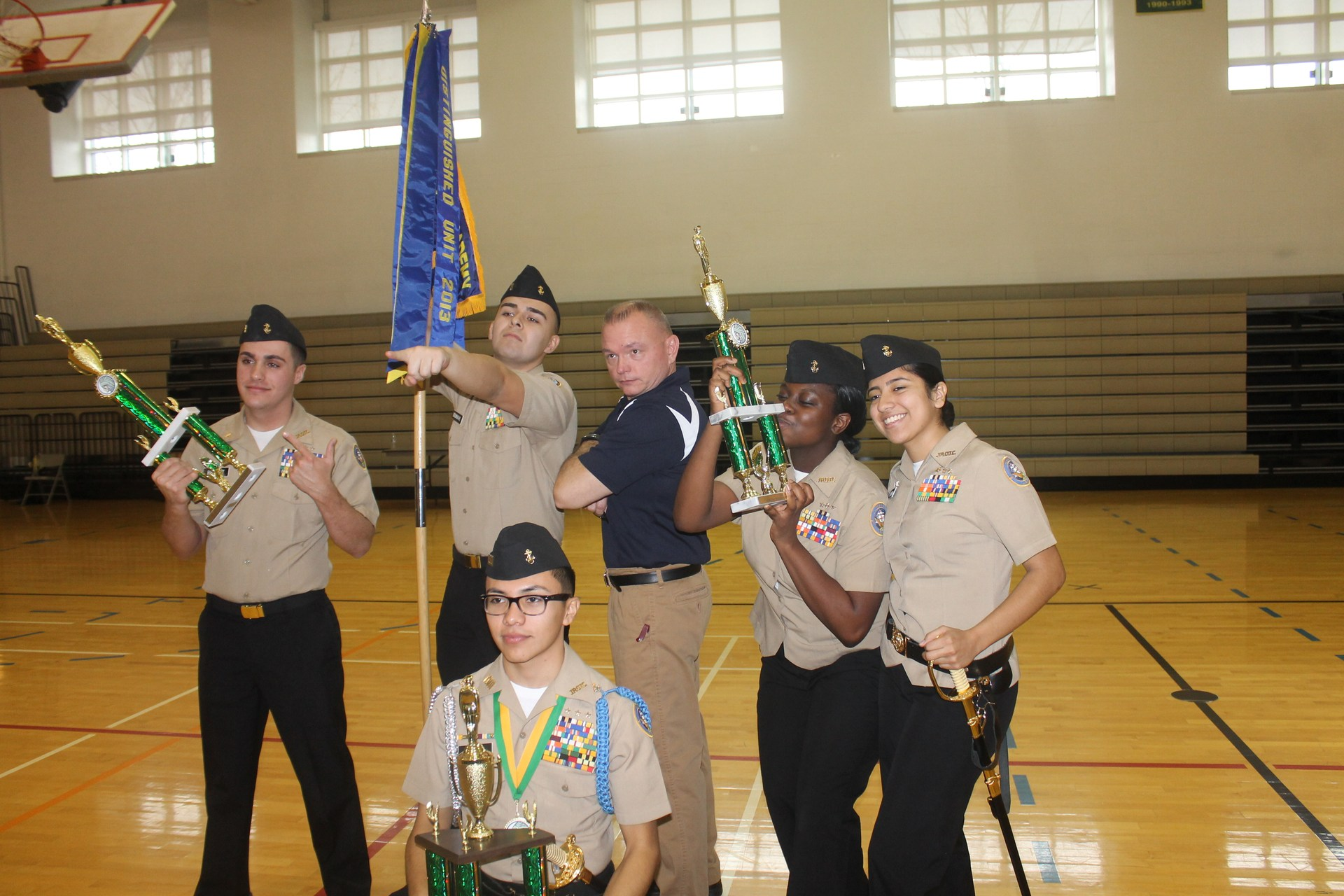 showing off our drill team and color guard trophies