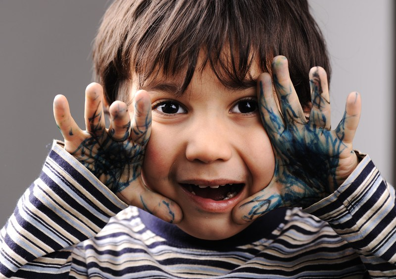 child with paint on his hands