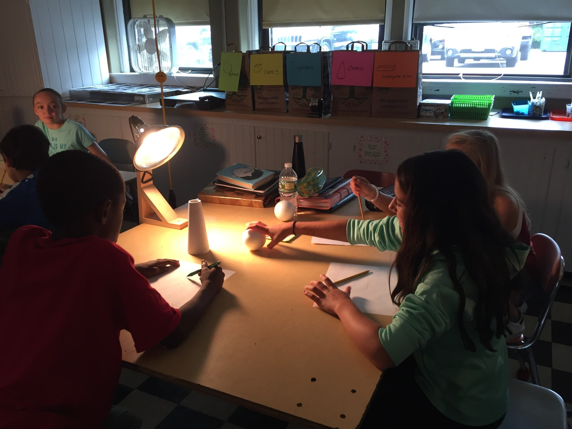 6th graders working on value study