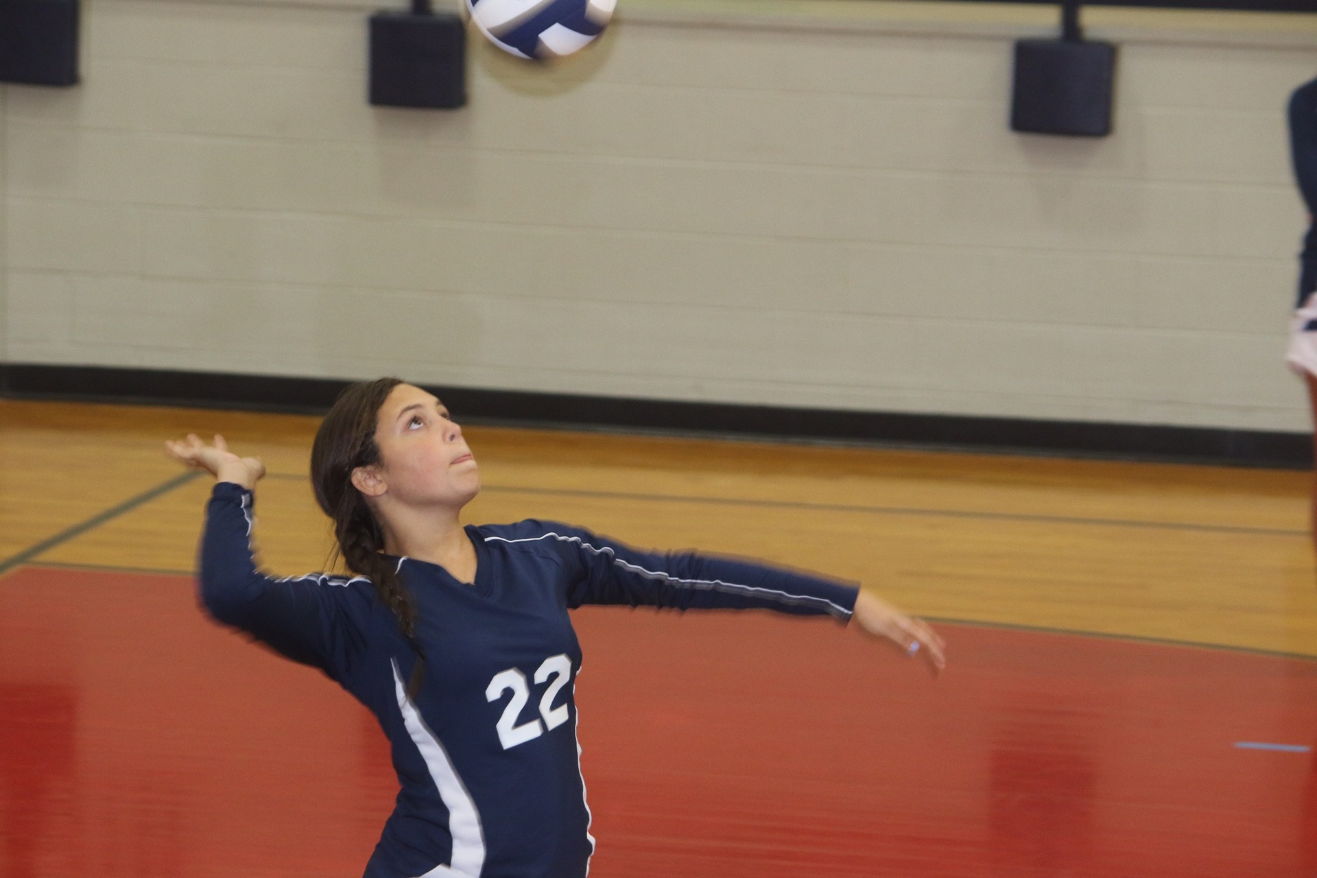 girl swinging to hit volleyball