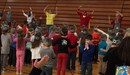 Zero the Hero leads McFall students in a 100th day celebration.